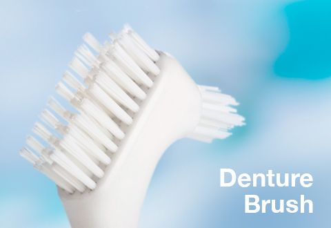 Use a denture brush to optimise your denture health and hygiene